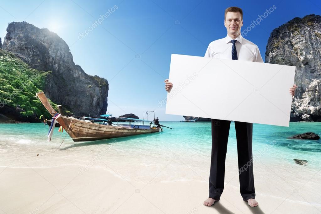 man on the beach of Thailand whith empty board in hand