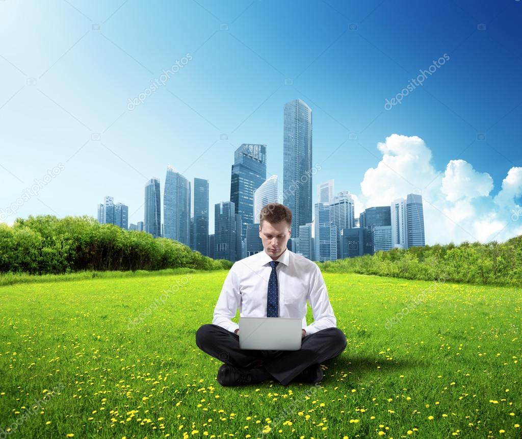 business man working in park