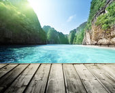 Photo rock of Phi Phi island in Thailand and wooden platform