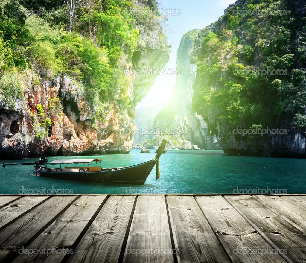 Фотообои Long boat and rocks on railay beach in Krabi, Thailand