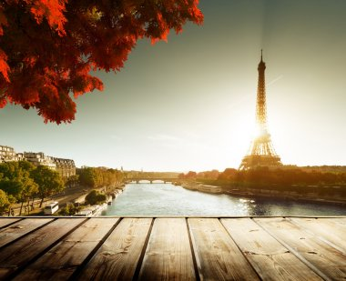 wooden deck table and Eiffel tower in autumn