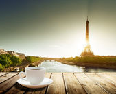 Fotografie coffee on table and Eiffel tower in Paris