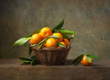 Still life with tangerines in a basket