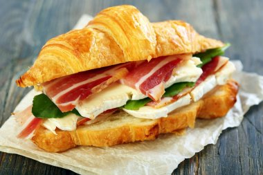 Croissant with ham and brie cheese.