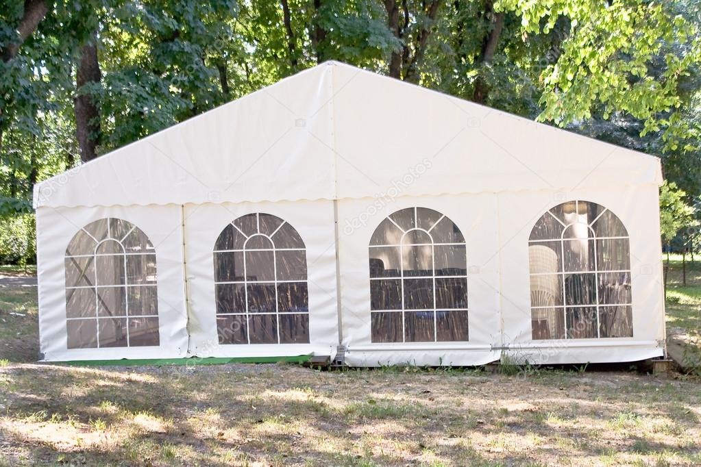 White big tent in forest