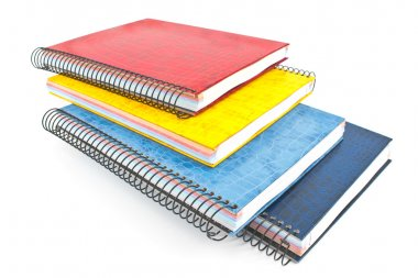 Stack of colorful spiral notebooks isolated on white