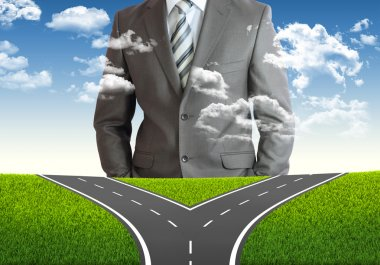 Businessman and fork in the road