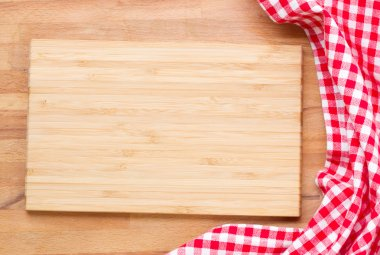 Cutting board and red napkin