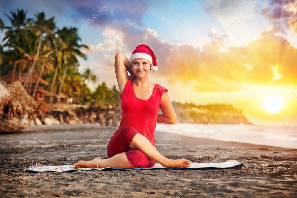 Christmas yoga in tropical beach