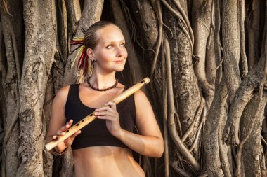 Woman with bamboo flute