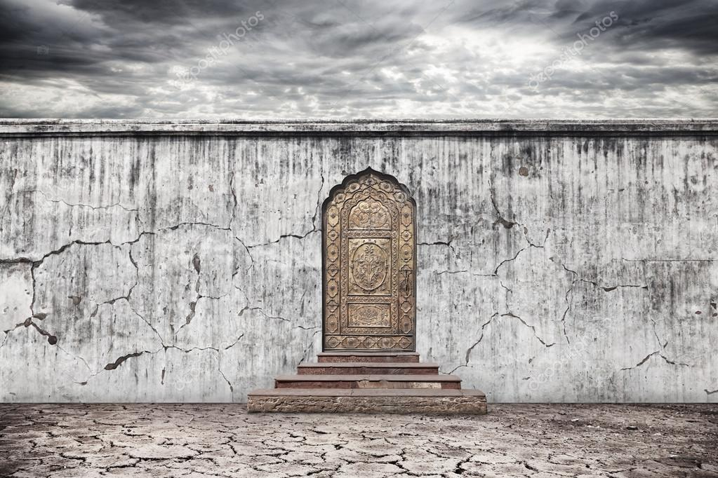 Wall with door on dry earth