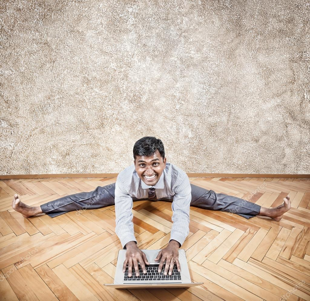 Indian Man Doing Yoga With Laptop Stock Photo C Byheaven 36144409