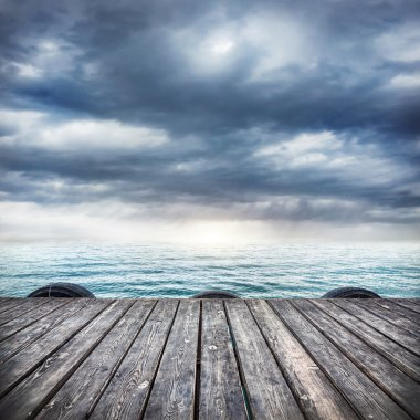 Wooden pier at overcast sky