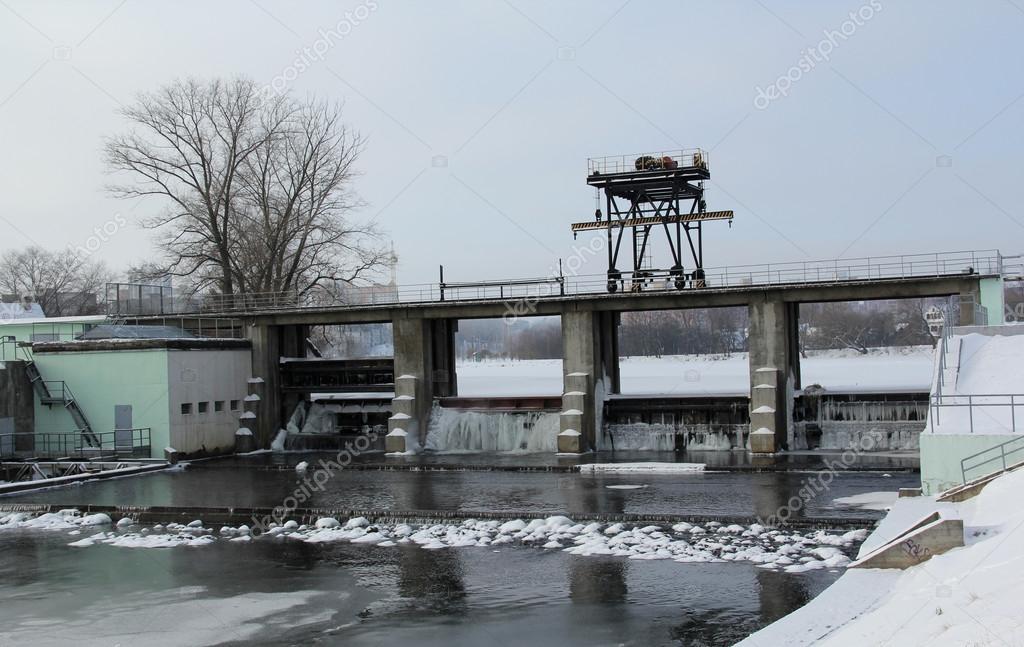 Dam in winter, water dam construction,
