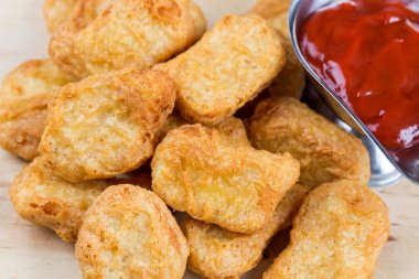 fast food fresh hot chicken nuggets with ketchup