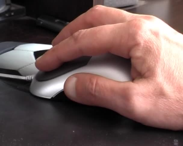 mans hand with a computer mouse