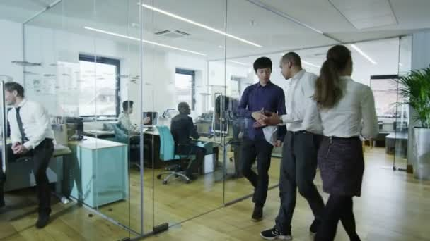 Young creative business team working together in a light contemporary office