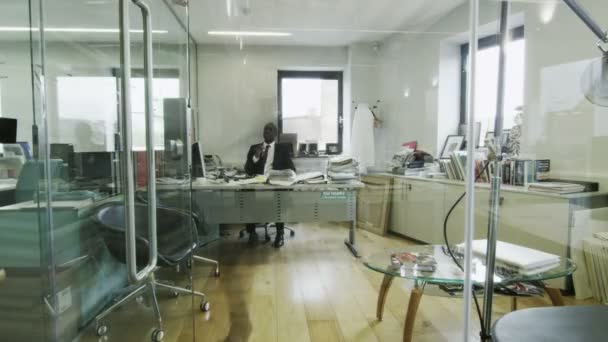 Time lapse of attractive young business team at work in busy modern office