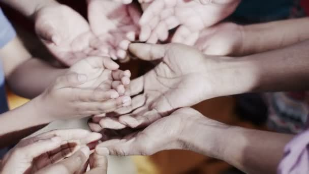 Many hands reaching out, begging for food or money