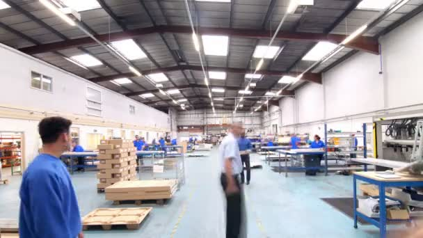 Male workers in warehouse preparing goods for dispatch