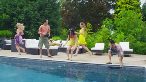 Excited group of friends arrive at vacation home and run to look at the pool