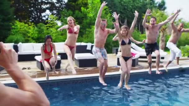 Friends pose in swimming pool