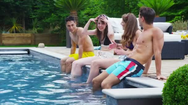 Mixed ethnicity friends enjoying pool party