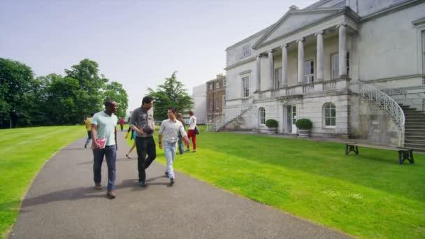 Mixed ethnicity students walk around university