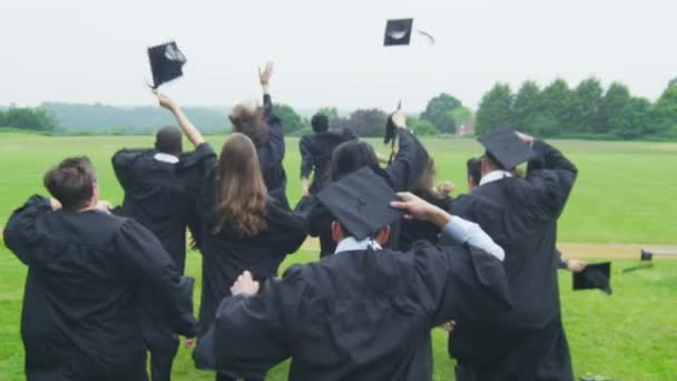 Students on graduation day run through landscape