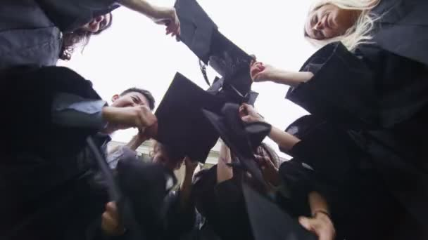 Student friends together outdoors on graduation day