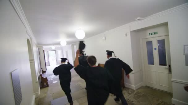 Students on graduation day running through hallway