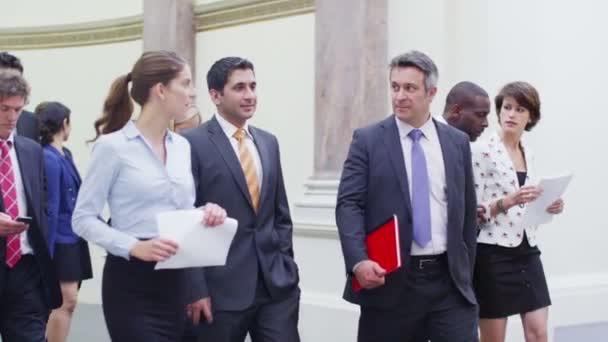 Business delegates chatting together