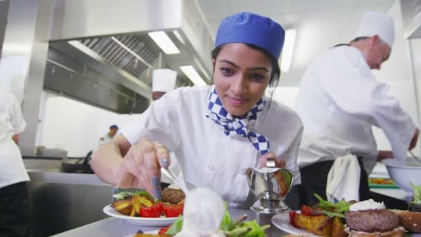 Meal being given finishing touches by chef