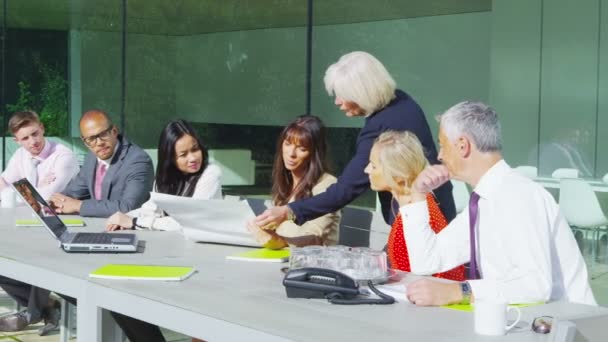 Diverse business team in outdoor meeting