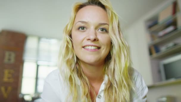 Woman having video chat from computer screen's pov