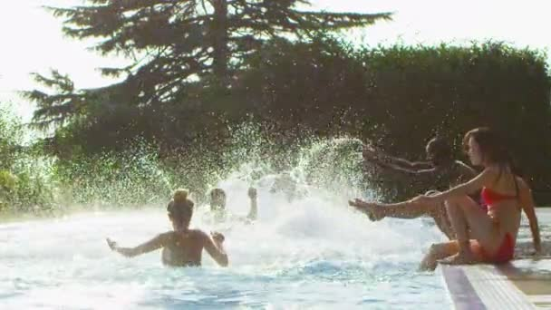 Friends splashing and playing in swimming pool