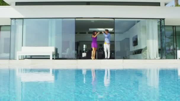Couple enjoying drinks by pool