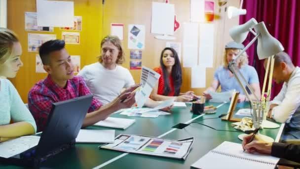 Creative business team in informal meeting