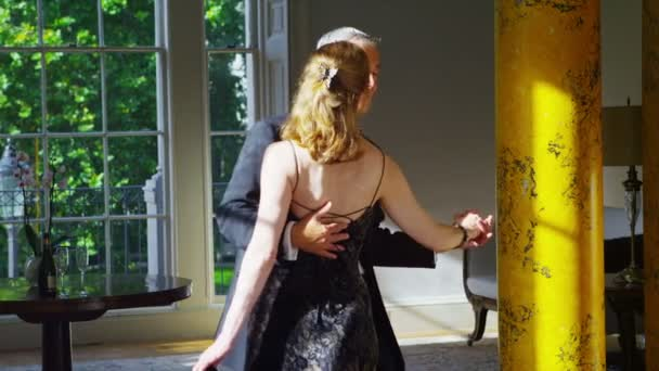 Mature couple in evening wear dancing