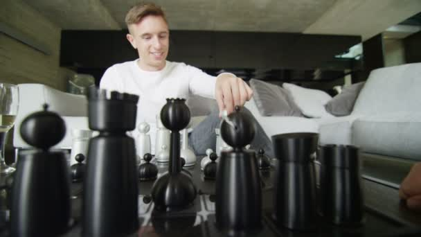 Two men play game of chess