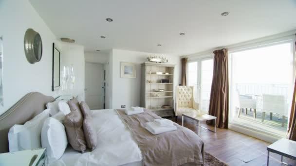 Elegant bedroom in stylish beachside home