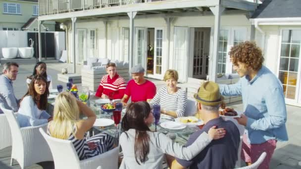 Family and friends enjoying meal outdoors