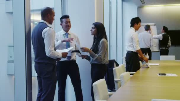 Diverse business team working together in meeting room of modern office