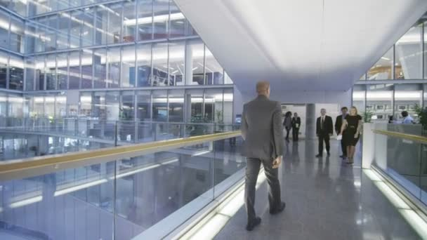Business group walking through one floor of office building
