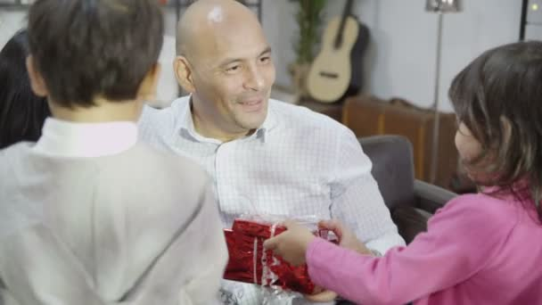 Children bring father gifts