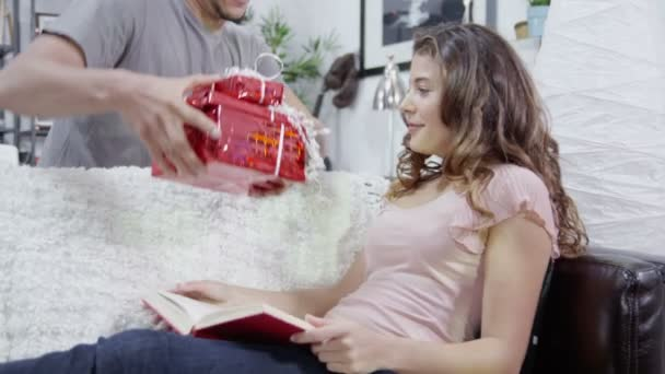 Young woman is given gifts by her partner