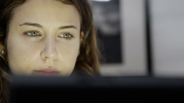 Tired woman working on computer