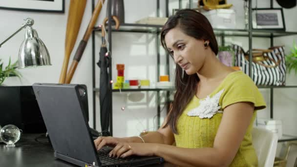 Attractive woman working at home on her laptop