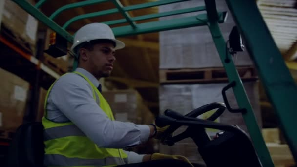 Forklift truck driver manoeuvring truck