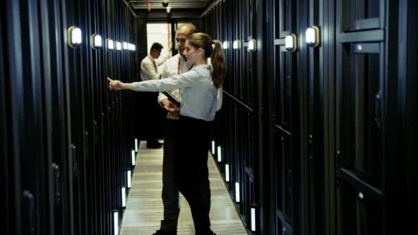 Team of people working at data centre
